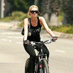 Paris Hilton rides a bike
