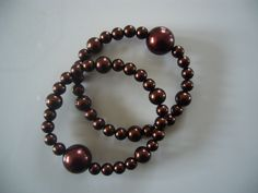 "Queasy Beads Motion Sickness Bracelets in ""Rich Chocolate"" (glass beads) $19.95, via Etsy."