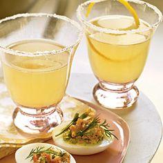 Champagne Limoncello Cocktails: 8 (3 x 1/2-inch) lemon rind strips; 8 tablespoons Limoncello; 4 teaspoons fresh lemon juice;1 (750-milliliter) bottle brut Champagne, chilled. Roll up each strip of lemon rind; place 1 into each of 8 Champagne flutes. Add 1 tablespoon liqueur and 1/2 teaspoon juice to each glass. Divide Champagne evenly among glasses. Serve immediately.