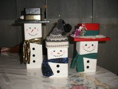 snowman family made from blocks of wood