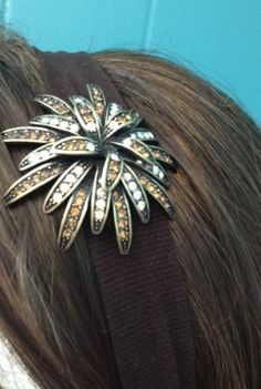 Premier Designs Notting Hill pin attached to a simple brown head band. facebook.com/CarolynPoppPremierDesignsJewelry.