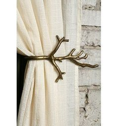 DIY this as a finials  Add a touch of character with this branch curtain tie-back. #home #decor