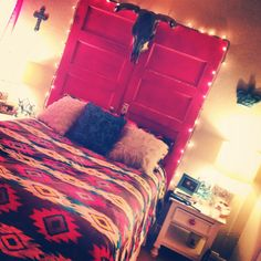 Western inspired room. ☺️love the headboard with old doors