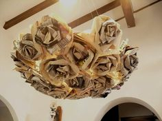 book page / newspaper chandelier... fantastic idea!