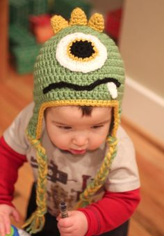 Crochet Monster Hats      My boys are turning 1 and 3 on the same weekend in March. This means we are having one BIG party for the both of them! I decided on a monster theme so get ready for a slew of monster related crafts this month :o) But the first order of business was to crochet them monster hats! I want to share with you the pattern I followed, but to tell you the truth, I kind of pieced this together from a bunch of different patterns so bear with me while I explain what I did.    I star