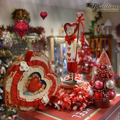 Our favorite 2013 Valentine decor piece is this 'vintage image' candy box by Bethany Lowe, paired with Allen Cunningham's Courting Cat and bottle brush trees with festooning ........so fun!