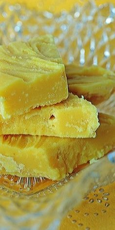 Lemon Fudge: 2 ¼ cups granulated sugar ¾ cup evaporated milk (not condensed, sweetened milk) 9 ounces white chocolate, cut into small pieces 1 stick of cold butter (4 ounces), cut into small pieces 1 ½ tablespoons lemon extract Zest of one lemon, finely minced A few drops yellow food coloring