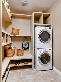 Smart Shelving Laundry Room: The stackable washer and dryer maximize vertical space, making room for lots of functional shelves. Lower shelves house shoes while upper shelves and cubbies make room for bags, baskets, and whatever the homeowners need to store. From HGTVRemodels.com