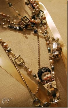 Lovely little doll necklaces