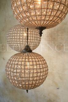 Beaded globe chandeliers.