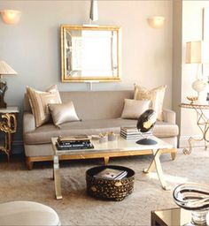 living rooms - X Coffee Table silk champagne beige sofa gilt gold beveled mirror silver sconces marble top gold accent tables gray walls living room X Coffee Table
