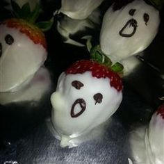 "White Chocolate Strawberry Ghosts | ""White chocolate dipped strawberries with dark chocolate piping make an adorable Halloween dessert!"""