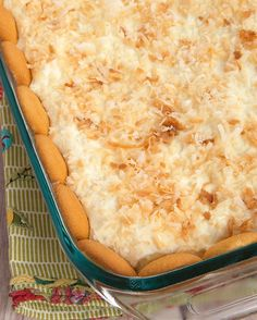Delicious layers of cream cheese, pudding, vanilla wafers, and toasted coconut make these Coconut Cream Pie Bars irresistible!