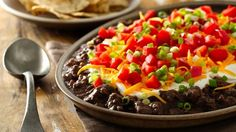 Expect to bring home an empty plate when you serve this colorful layered Mexican dip. It gets a kick from the chorizo sausage and creamy goodness from Progresso® Vegetable Classics hearty black bean soup.