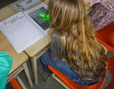 Students use dollar store finger laser lights for close reading to laser in on the information they want to make a connection to, that is new learning or that they have a question about.