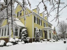 colonial home-love the yellow against the snow