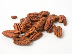 Spiced nuts are total crowd-pleasers that don't require any prep more than dumping 'em into pretty bowls for serving. We tried 12 varieties from Trader Joe's to see which ones to stock up on this holiday season.