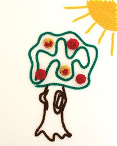 This fun pompom-adorned yarn tree is a great project for kids. Shown in Bernat Super Value.