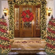 Christmas outdoor decoration of house in night view Exterior decoration of house for Christmas with Santa Claus dolls and x mas trees wallpa...