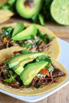 Crock Pot Beef Carne Asada Tacos - These tacos are off the chain. A lovely piece of flank steak gets a spicy rubdown before sitting in the crock pot for eight hours with onion, bell pepper and jalapeno. Never thought to put steak in the crock pot? Well, let me tell you—it can be done!