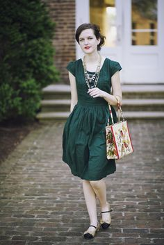 green dress + layered necklaces + ballet flats (Marais Manor Mary Jane).