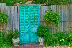 turquoise gate with louvers