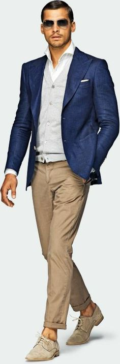 Blue jacket, grey sweater, white shirt, khaki pants