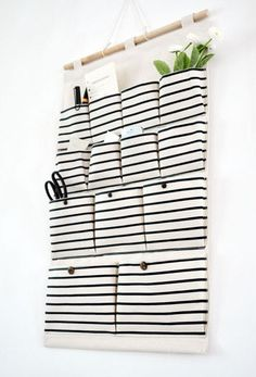 13 pockets storage pocket /wall pocket / wall Storage bag / household storage   Would be great for the door of the bathroom or bedroom