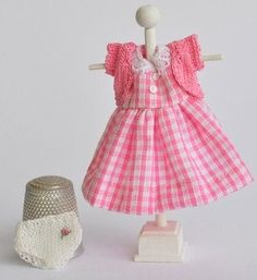 cute dress, but nice dress stand too. would be great for displaying doll clothes for sale Or a bit bigger for baby clothing highlight on a table or shelf at show