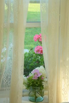 screen windows, lace curtains, and flowers :)