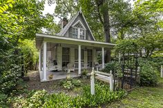 This cute-as-a-button cottage is currently on the market — and we're head-over-heels in love.