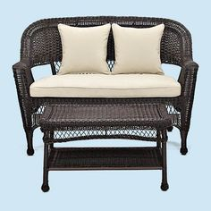 All-weather wicker gets a sophisticated update in black with cream-colored cushions. | @wayfair