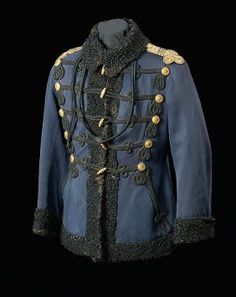 Austrian Cavalry Officer's Hussar Dolman Shoulder Coat, dark blue tunic with black fur trim and black silk lining. Gold gilt buttons and officer's shoulder straps. Black cords and frogs.