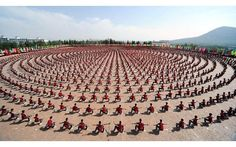 EVERYBODY WAS KUNG FU FIGHTING    Photograph by China Foto Press    The Daily Mail purports this is a display of approximately 10,000 students but commenters on Reddit tend to have more conservative estimates around 3000-3500. Regardless, it's an impressive coordinated display and reminiscent of the incredible performance China put on for the Olympics in Beijing. Paging Bruce Lee, Jet Li, Jackie Chan, Tony Jaa, Chuck Norris and Beatrix Kiddo!
