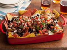 Super Nachos. Rachael Ray tops her Méxican-style meal with traditional nacho fixings, including homemade pico de gallo salsa, made with ripe tomatoes, a Jalapeño pepper and fragrant cilantro. This is real party food! YUM!