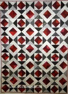 <3 this!  Red, black and white quilt with no name.