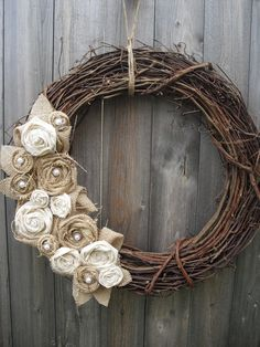 I normally don't like twig wreaths...but I like this one with the burlap and muslin rosettes with pearls