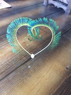 peacock, cake topper, center piece, table decoration, wedding decoration. FREE SHIPPING HEART shaped peacock cake topper via Etsy peacock feathers, table decorations, idea, peacock cake topper, simple peacock wedding cake, heart shape, peacock wedding cake topper, feather wedding cakes, cake toppers