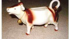 vintage-hummel-goebel-cow-creamer-figurine-w-bell-germany-brn-spots-bee-v_180808935357.jpg 400×229 pixels