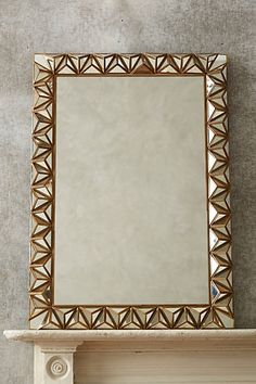 Studded Pyramid Mirror #Anthrofave #bronzedecor