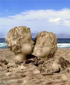 sculpted heads in the sand. wow!