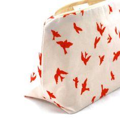 Makeup Bag in Clementine Orange Birds in Flight by JordaniSarreal, $11.95