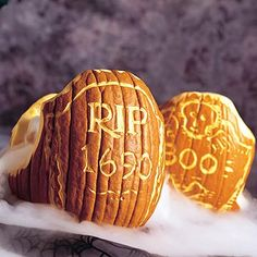 Use pumpkins as gravestones by carving the information of the deceased on its side... Pumpkin Masters' Surface Carving Kits can help transform gourds to gravestones without prematurely decomposing them: http://www.pumpkinmasters.com/pumpkin-carving-kits.asp. Idea via Dofaso Blog.