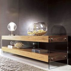 Media table with glass sides that give it the appearance of floating.