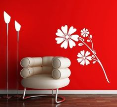 The red wall with the white flower design is really neat and the chair is super duper fun too!