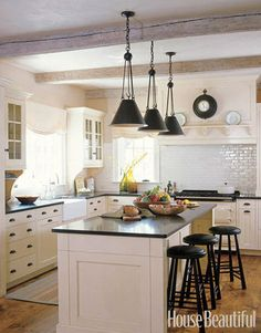Black & white farmhouse kitchen with exposed beams (Susan Tully, House Beautiful)