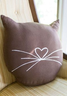 Feline Cozy Pillow. Transform your space into a comfy oasis with this cute cat-themed pillow from Karma Living! #gold #prom #modcloth