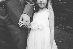 Holding hands. Flower girl in white with dad.  Photo from Anne+Joe's Wedding collection by Alyssa Maloof Photography