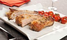 Costillas de cero asadas. Receta de costillas de cerdo maceradas con ajo y aceite de oliva y asadas al horno. Acompañamos las costillas de cerdo con unos tomates cherry salteados. #costillas #ribs