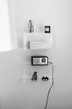 Clear boxes give the illusion of floating objects on the wall. We dig. #diy